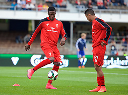 HELSINKI, FINLAND - Friday, July 31, 2015: Liverpool's Divock Origi wearing pink boots warms up before a friendly match against HJK Helsinki at the Olympic Stadium. (Pic by David Rawcliffe/Propaganda)