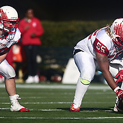 Smyrna center Ty-Kee Moore (55) prepares to snap the ball during the DIAA division one Football Championship game between Top-seeded Middletown (11-0) and second-seeded Smyrna (11-0) Saturday, Dec. 03, 2016 at Delaware Stadium in Newark.