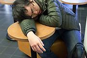 boy sleeping in a public space Japan