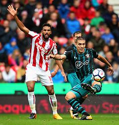 Oriol Romeu of Southampton clears under pressure from Eric Maxim Choupo Moting of Stoke City - Mandatory by-line: Matt McNulty/JMP - 30/09/2017 - FOOTBALL - Bet365 Stadium - Stoke-on-Trent, England - Stoke City v Southampton - Premier League