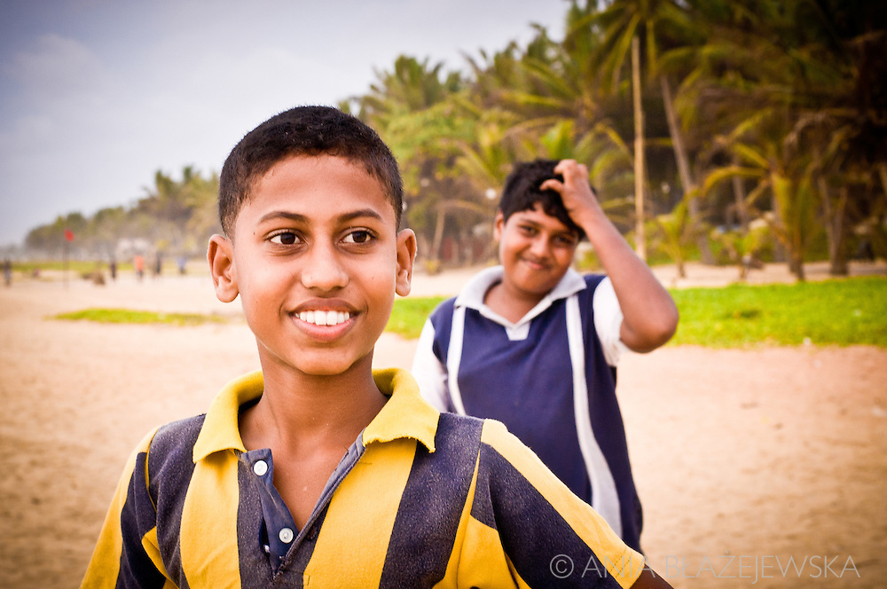 Sri Lanka, Negombo. Two smiling boys at the beach.