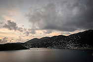 A commercial airliner departs at sunset from Charlotte Amalie, St. Thomas, US Virgin Islands