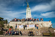 LESVOS, GREECE - NOV 6: Refugees gather around the Statue of Liberty at the port of Mytilene, Lesbos to commemorate the thousands of people who drowned in the Aegean Sea trying to reach the safety of European shores.