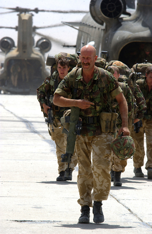 "British Operation Buzzard officially ends as Royal Marines of 45 Commando ""Yankee"" company return to Bagram airbase on July 9, 2002 from their mission in South Eastern Afghanistan. Operation Buzzard was the last planned combat mission for the British forces, who are expected to complete their troop pullout from Afghanistan later this month."