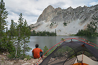 Adult male enjoying the view at a backcountry camp at Alice Lake Sawtooth Mountains Idaho