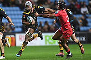 Wasps back row Nizaam Carr (8) is grabbed by Saracens winger Ali Crossdale (23) during the Gallagher Premiership Rugby match between Wasps and Saracens at the Ricoh Arena, Coventry, England on 21 February 2020.
