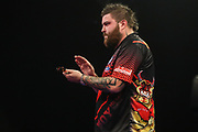 Michael Smith applauds his opponent during the Grand Slam of Darts, at Aldersley Leisure Village, Wolverhampton, United Kingdom on 11 November 2019.