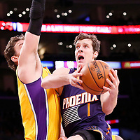10 December 2013: Phoenix Suns shooting guard Goran Dragic (1) goes for the layup against Los Angeles Lakers center Pau Gasol (16) during the Phoenix Suns 114-108 victory over the Los Angeles Lakers at the Staples Center, Los Angeles, California, USA.