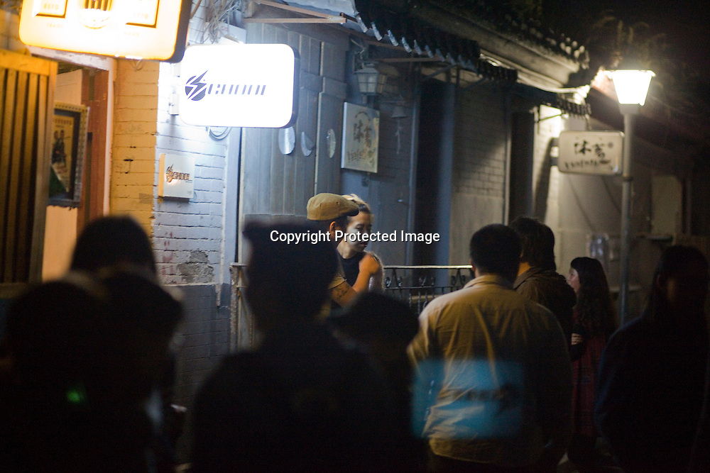 BEIJING, SEPT.30 : A group of young peopel stand outside School Bar, a  new trendy music venu in Beijing.