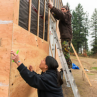 """Mayuk Manuel and her partner Isha Jules building """"Tiny Houses."""" These """"Tiny Houses"""" being built by First Nations in Secwepemc territory, are to protest Kinder Morgans proposed construction of the Trans Mountian pipeline twinning. They plan to build ten tiny homes to be placed along and block construction of the pipeline route through Secwepemc territory. Begun by the Mayuk Manuel and her twin sister Kanahus, and with support from Mayuk's partner Isha Jules, they call themselves the Tiny House Warriors. PLEASE NOTE. NOT MODEL RELEASED. please contact those photographed for permission to publish."""