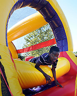 Nahmere Moore, 11 climbs through an inflatable obstacle course during community day at the Bristol Township Building Saturday August 22, 2015 in Bristol, Pennsylvania. (Photo by William Thomas Cain)