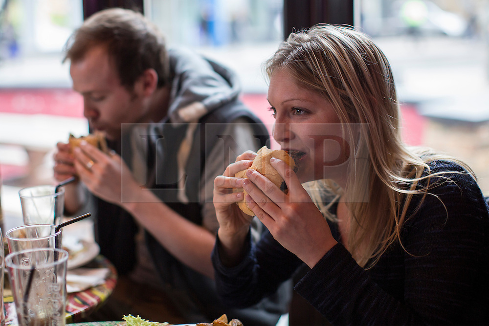 © licensed to London News Pictures. London, UK 15/03/2013. Hamilton Ross (left) and Bea Beazley eating 100% horse meat burgers at The Lord Nelson pub in Southwark, London as the pub starts to serve 100% horsemeat burgers to their customers. Photo credit: Tolga Akmen/LNP