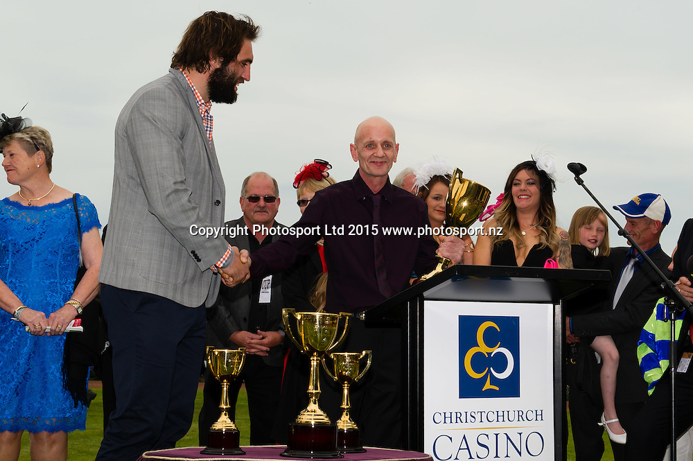 Owner Leon Andrew  recieves the NZ Cup from Sam Whitelock, the Christchurch Casino 152nd New Zealand Cup during the New Zealand Cup Meeting at Riccarton Park, Christchurch. 14th November 2015. Copyright Photo: John Davidson / www.photosport.nz