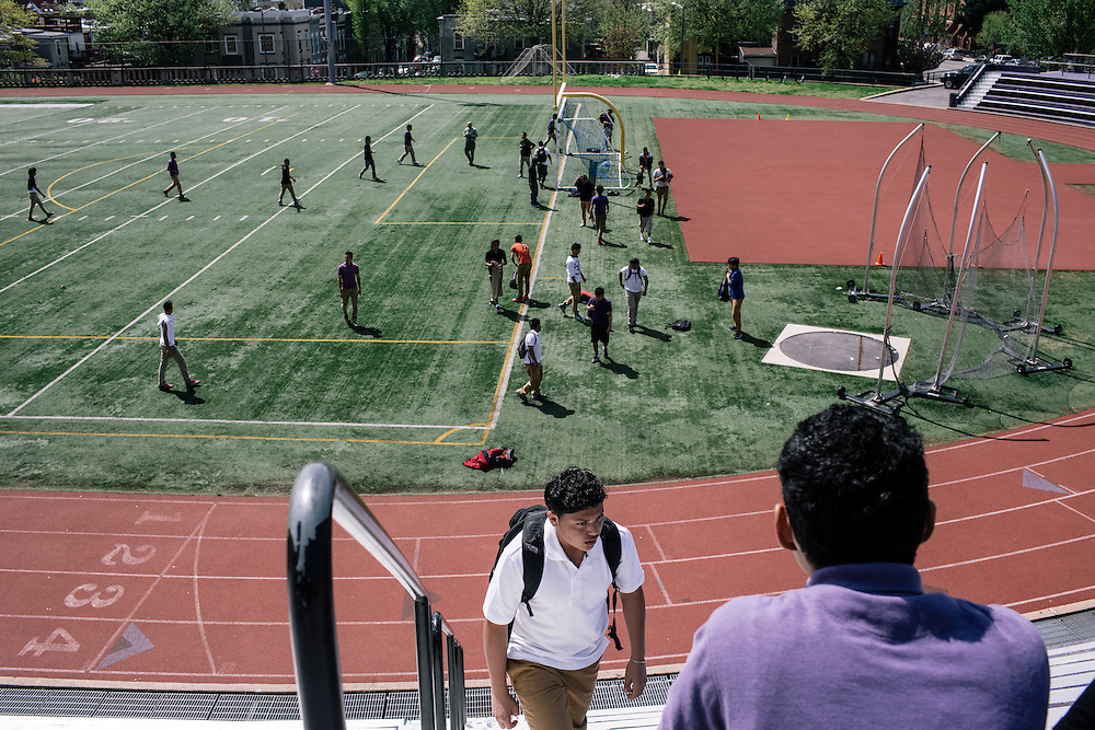 Students in Washington D.C.'s first-year International Academy for English-language learners, including Andres Jaime, 17, originally from El Salvador, center, head back to class after playing a game of soccer during their lunch hour on the school turf at the International Academy at Cardozo Education Campus on April 22, 2015. The program is aimed at dealing with the influx of unaccompanied minors, mostly from Central American countries, and allows them to be in classes of 25 together. Currently Cardozo, in NW Washington DC has about 200 of these students.