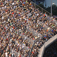 Fans fill the seats on the front stretch during the NASCAR Coke Zero 400 Sprint series auto race at the Daytona International Speedway on Saturday, July 6, 2013 in Daytona Beach, Florida.  (AP Photo/Alex Menendez)