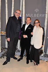 Left to right, MICHAEL HOWELLS and Condé Nast International Chairman and Chief Executive JONATHAN NEWHOUSE and his wife RONNIE at a Dinner to celebrate the launch of the Mulberry Cara Delevingne Collection held at Claridge's, Brook Street, London on 16th February 2014.