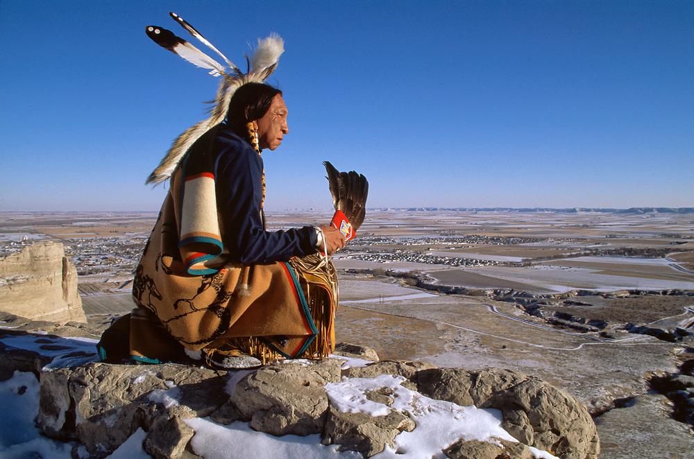 Lakota elder sitting on bluff at Scotts Bluff National Monument, Oregon trail, Nebraska,USA