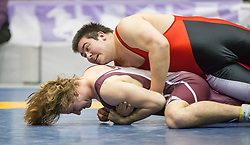 London, Ontario ---2013-03-02--- Andrew Balach of Mcmaster takes on Robert Hermanto of Memorial in the men's 130 KG 7th/8th match at the 2013 CIS Wrestling Championships in London, Ontario, March 02, 2013. .GEOFF ROBINS/Mundo Sport Images