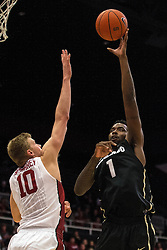 Colorado forward Wesley Gordon (1) shoots over Stanford forward Michael Humphrey during the first half of an NCAA college basketball game in Stanford, Calif., Sunday, Jan. 3, 2016. Colorado won 56-55. (AP Photo/Jason O. Watson)