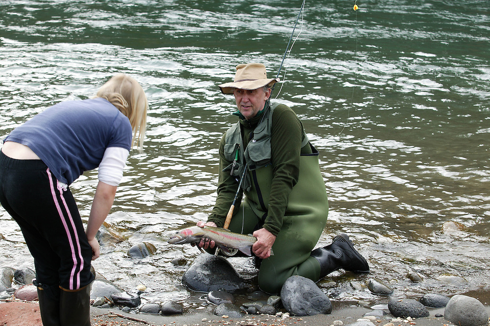 A trout fisherman shows off a rainbow trout caught in the Major's pool on the famed Tongariro River at Turangi, New Zealand, October 01, 2004. Credit:SNPA / Rob Tucker