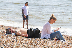 © Licensed to London News Pictures.09/04/2020. Brighton, UK. Members of the public take to the beach in Brighton and Hove as warmer weather is hitting the seaside resort. Photo credit: Hugo Michiels/LNP