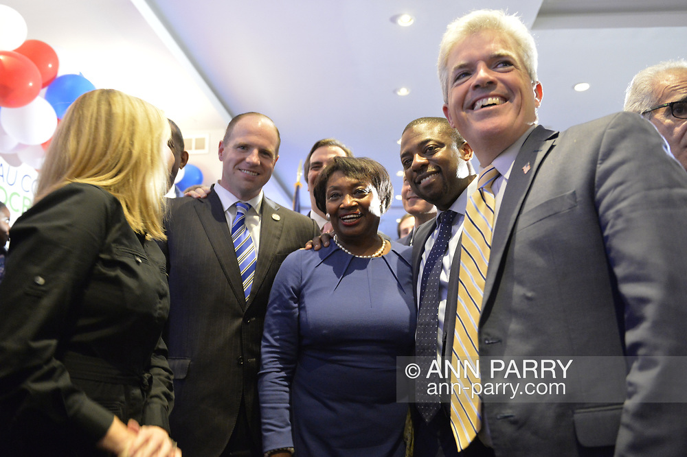 Garden City, New York, USA. November 6, 2018. Nassau County Democrats watch Election Day results at Garden City Hotel, Long Island. On stage were elected officials and candidates who won election, including, at center in blue, ANDREA STEWART-COUSINS, who represents District 35 in the New York State Senate, serves as Senate Democratic Leader. At far right is Suffolk County Executive STEVE BELLONE, and, at far left is Hempstead Town Supervisor LAURA GILLEN.