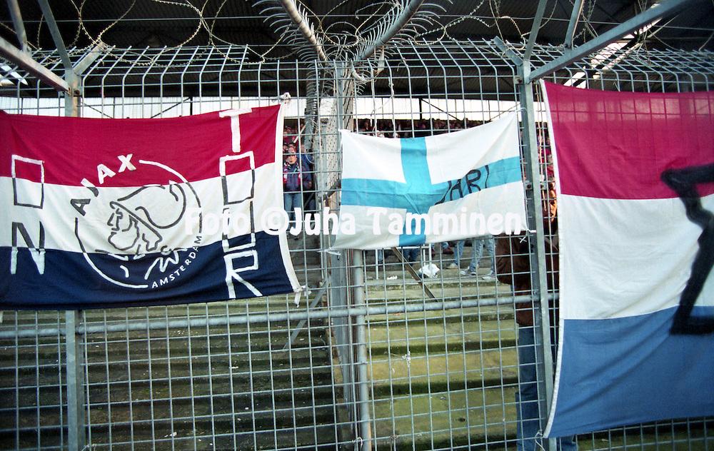 28.11.1993, Ajax Stadion, Amsterdam, Netherlands. <br /> Dutch Eredivisie, AFC Ajax v Go Ahead Eagles.<br /> Jari Litmanen fan's Finland flag tied to the fence.