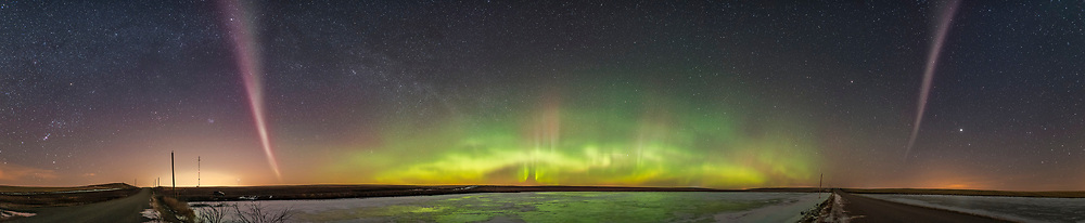 A panorama from west (left) to southeast (right) of an aurora display, March 2, 2017, from southern Alberta, with a classic aurora oval to the north, and the odd-looking isolated arc to the west and east (and it passed overhead) glowng pink in color, with a bare hint of green fringe. These arcs are not uncommon but seem to be unique to latitudes far to the south of the main auroral oval. In this case, the arc was overhead for us at 51&deg; North, while the main oval was 5&deg; to 10&deg; farther north. <br />