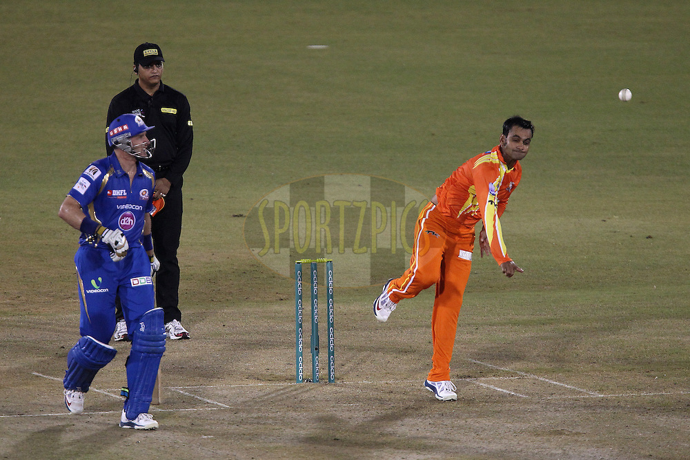 Muhammad HAFEEZ (Captain) of the Lahore Lions during the qualifier 2 match of the Oppo Champions League Twenty20 between the Mumbai Indians and the Lahore Lions held at the Chhattisgarh International Cricket Stadium, Raipur, India on the 13th September 2014<br /> <br /> Photo by:  Ron Gaunt / Sportzpics/ CLT20<br /> <br /> <br /> Image use is subject to the terms and conditions as laid out by the BCCI/ CLT20.  The terms and conditions can be downloaded here:<br /> <br /> <br /> http://sportzpics.photoshelter.com/gallery/CLT20-Image-Terms-and-Conditions-2014/G0000IfNJn535VPU/C0000QhhKadWcjYs