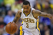 April 21, 2012; Indianapolis, IN, USA; Indiana Pacers shooting guard George Hill (3) brings the ball up court against the Philadelphia 76ers at Bankers Life Fieldhouse. Philadelphia defeated Indiana 109-106. Mandatory credit: Michael Hickey-US PRESSWIRE