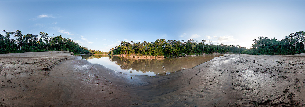 Panoramic view of the Las Piedras river and the rainforest along its muddy river bench, Peru
