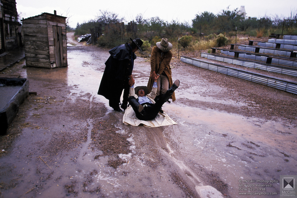 Tombstone Vigilantes drag cowboy through puddle, Helldorado Days, Tombstone, Arizona. ©Edward McCain/McCain Creative, Inc. All Rights Reserved 520-623-1998