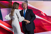 Republican Presidential nominee Donald Trump embraces his wife Melania after introducing her during the first day of the Republican National Convention at the Quicken Loans Center July 18, 2016 in Cleveland, Ohio.