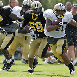 01 August 2009: New Orleans Saints running back Herb Donaldson (40) runs past defensive end Anthony Hargrove (69) during New Orleans Saints training camp at the team's practice facility in Metairie, Louisiana.