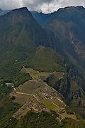 Panoramic view of the lost inca city of Machu Picchu, in Cusco, Peru. Now one of the new seven wonders of the modern world.