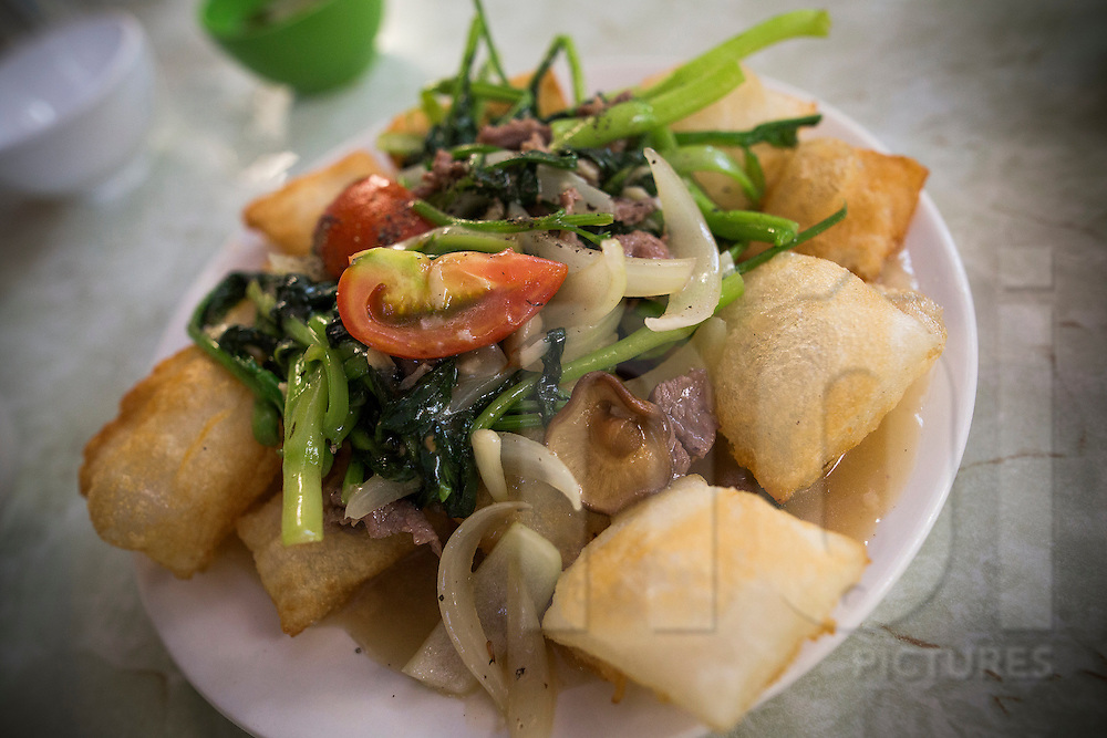 "Traditional vietnamese dish ""pho chien phong"", a fried noodle based dish with beef and veggies . Hanoi, Vietnam, Southeast Asia"