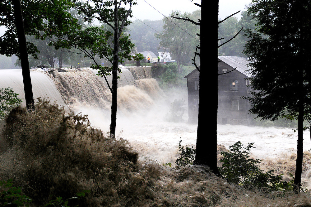 Kennedy's Pond pours over the damaged Ascutney Mill Dam in Windsor, Vt. Sunday, August 28, 2011. <br /> Valley News - James M. Patterson<br /> jpatterson@vnews.com<br /> photo@vnews.com