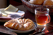 Melander children's breakfast of cinnamon roll, cheese, meat, and hot tea in Bargteheide, Germany. (From a photographic gallery of meals in Hungry Planet: What the World Eats, p. 244). The Melander family of Bargteheide, Germany, is one of the thirty families featured, with a weeks' worth of food, in the book Hungry Planet: What the World Eats.