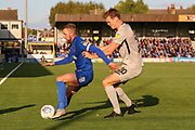 AFC Wimbledon midfielder Scott Wagstaff (7) battles for possession with Portsmouth defender Sean Raggett (20) during the EFL Sky Bet League 1 match between AFC Wimbledon and Portsmouth at the Cherry Red Records Stadium, Kingston, England on 19 October 2019.