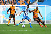 Brighton striker, Sam Baldock shields the ball from Hull City defender Isaac Hayden during the Sky Bet Championship match between Brighton and Hove Albion and Hull City at the American Express Community Stadium, Brighton and Hove, England on 12 September 2015. Photo by Geoff Penn.