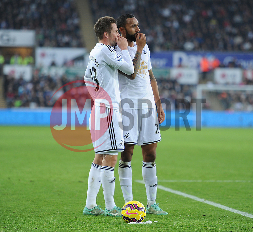 Swansea City's David Cornell and Swansea City's Kyle Bartley talk about the free kick. - Photo mandatory by-line: Alex James/JMP - Mobile: 07966 386802 - 29/11/2014 - Sport - Football - Swansea -  - Swansea v Crystal palace  - Barclays Premier League