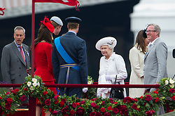 © Licensed to London News Pictures. 03/06/2012. London, UK. HRH The Queen pulling a face as she is greeted by Prince William, Prince Harry and Catherine Duchess of Cambridge on board Royal Barge Spirit of Chartwell during the Jubilee Pageant on the River Thames, London on June 03,2012 as part of The Diamond Jubilee celebrations. Great Britain is celebrating the 60th  anniversary of the countries Monarch HRH Queen Elizabeth II accession to the throne . Photo credit : Ben Cawthra/LNP