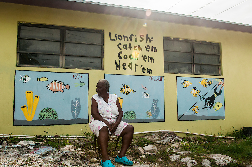 A mural is painted on the side of a small grocery store on Eleuthera Island, Bahamas depicting how the fate of the Bahamian fishery is tied closely to that of the invasive lionfish. An island elder looks to the past as a healthy fishery becomes embattled.