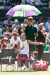 © Licensed to London News Pictures. 03/07/2018. London, UK. Petra Kvitova of the Czech Republic plays Aliaksandra Sasnovich of Belarus in the women's singles 1st round draw of the Wimbledon Tennis Championships 2018, Day 2. Photo credit: Ray Tang/LNP. Photo credit: Ray Tang/LNP