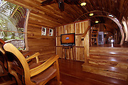 - Costa Verde, Costa Rica - <br /> <br />  Hotel Costa Verde is proud to present its newest lodgings: The fully outfitted, meticulously detailed, two bedroom, Boeing 727 fuselage suite. We have refurbished a vintage 1965 Boeing 727 airframe, which in its prior life shuttled globetrotters on South Africa Air and Avianca Airlines (Colombia). Our phoenix is now ready for its future duty as the most exclusive hotel suite in Costa Rica. We salvaged this airframe, piece by piece, from its San Jose airport resting place. We carefully transported the pieces on five, big-rig trucks to the jungles of Manuel Antonio where they have been resurrected into a unique jumbo hotel suite. Our classic airplane, nestled on the edge of the National Park in our Costa Verde II area, is perched on a 50-foot pedestal. At this height, you will enjoy scenic ocean and jungle views from the hard wood deck built atop the plane's former right wing. The plane's interior is Costa Rican teak paneling from the cockpit to the  tail. Furnishings are hand-carved, teak furniture from Java, Indonesia.  Our 727 home features two air conditioned bedrooms--one with two  queen sized beds and the other with one queen sized bed, each with its  own private bath-a flat screen TV, a kitchenette, dining area foyer; an ocean view terrace; a private entrance up a river rock, spiral staircase; and 360 degrees of surrounding gardens.Enjoy an evening on the terrace while sipping a glass of wine and observing your tree top neighbors: sloths, toucans and monkeys. Our refurbished Boeing 727 home is not the only such dwelling in the world: We were inspired by a Forbes Magazine article about a company offering hurricane-proof living via surplus Boeing 727 airframes! Of course, Photo Shows:  727 Hotel Entrance <br /> (Credit Image: © Vincent Costello/Exclusivepix