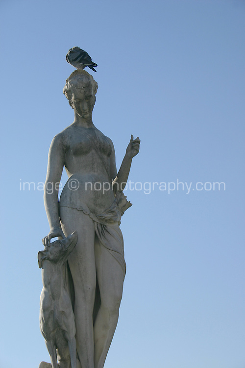 Statue with bird in Tuileries gardens, Paris, France<br />