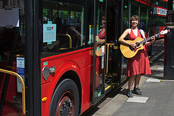 "London, July 18th 2015. Regular Southbank busker Emily Lee sings songs from her recently released EP ""Don't Forget To Love"" on the Busking Bus as part of the Busk in London Festival aimed at showcasing the outstanding talents of many of the capital's finest street performers, including, musicians, magicians, living statues jugglers and bands."