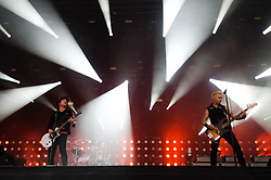 © Licensed to London News Pictures. 01/06/2013. London, UK.   Green Day performing live at The Emirates Stadium - Billie Joe Armstrong (left), Tre Cool (centre), Mike Dirnt (right) . Green Day is an American punk rock band formed in 1987. The band consists of lead vocalist and guitarist Billie Joe Armstrong, bassist and backing vocalist Mike Dirnt, drummer Tré Cool and guitarist and backing vocalist Jason White.  Photo credit : Richard Isaac/LNP