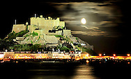 The mighty castle of Mont Orgueil stands guard over Jersey's eastern coast on a moonlit night. The 12th century fort has even been used by the Nazis during WWII.