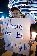 November 10, 2008 -- PHOENIX, AZ:  A gay rights demonstrator at a vigil in Phoenix Monday. About 250 people attended a candle light vigil in support of gay rights and gay marriage in Phoenix, AZ, Monday night. The rally, like similar ones in Los Angeles and Salt Lake City, were in response to anti-gay marriage and anti-gay rights initiatives that were passed by the voters in Arizona, California and Florida. The anti-gay initiatives in Arizona and California were funded by conservative churches, including the Church of Latter Day Saints (Mormons). Photo by Jack Kurtz / ZUMA Press